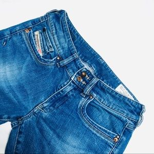 DIESEL RONHAR STRETCHY BOOTCUT JEANS.